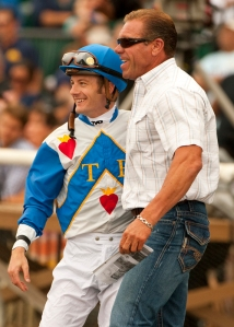 Jockey Julie Leparoux, left, and trainer Jeff Mullins are all smiles after Sirocco Strike is made the winner of the Green Flash Handicap on Wednesday at Del Mar. BENOIT PHOTO