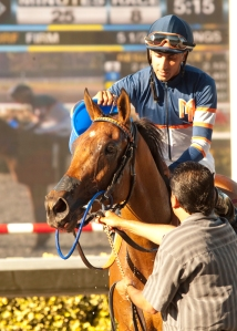 Nick Alexander's Sunday Rules and Edwin Maldonado win the $150,000 Generous Portion Stakes Wednesday at the Del Mar Thoroughbred Club.  © Benoit Photo